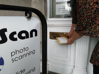 hand delivering your scanned photo